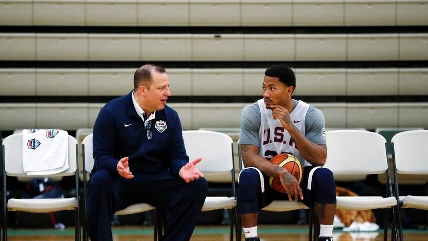 Assistant Coach Tom Thibodeau, left, and Derrick Rose speak during a practice of the men's U.S. National basketball team on Friday, Aug. 15, 2014, in Chicago. The U.S. team will face the Brazilian team in an exhibition game at the United Center in Chicago on Saturday. (AP Photo/Andrew A. Nelles)