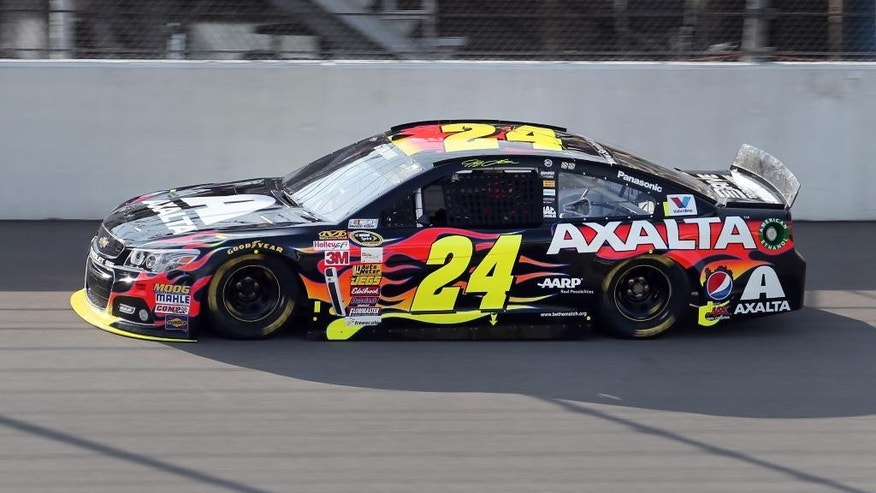Jeff Gordon qualifies in the final session winning the pole position for the NASCAR Sprint Cup Series auto race at Michigan International Speedway in Brooklyn, Mich., Friday, Aug. 15, 2014. (AP Photo/Bob Brodbeck)