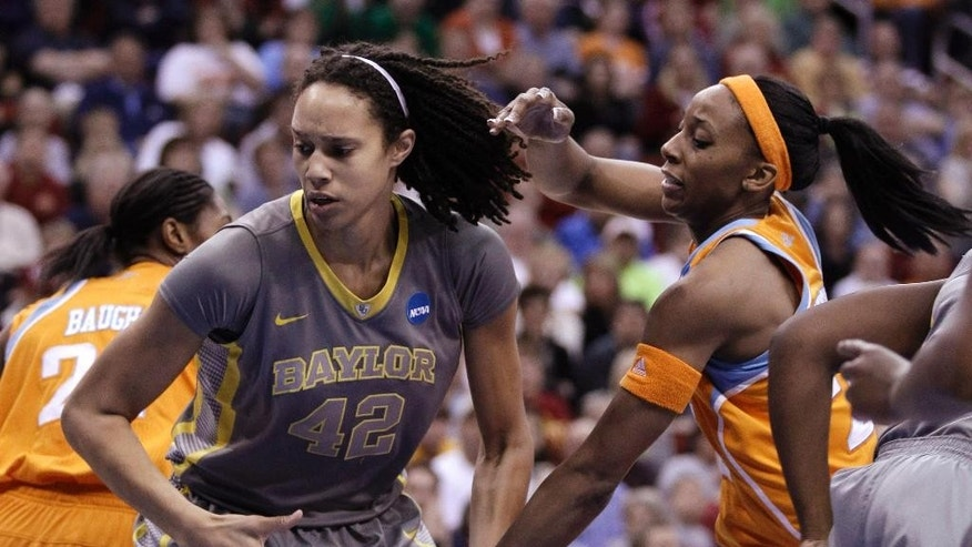 FILE  - In this March 26, 2012, file photo, Baylor's Brittney Griner grabs a rebound in front of Tennessee's Glory Johnson during an NCAA women's college basketball tournament regional final in Des Moines, Iowa. Phoenix Mercury center Griner has proposed to Tulsa Shock's Johnson and posted it on social media. Griner showed a photo of her on one knee with a ring in her hand in front of Johnson on her Instagram account. (AP Photo/Charlie Neibergall, File)