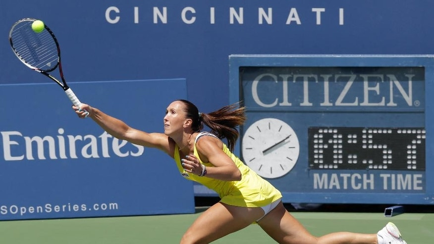 Jelena Jankovic, from Serbia, returns a serve against Serena Williams during a match at the Western & Southern Open tennis tournament, Friday, Aug. 15, 2014, in Mason, Ohio. Williams won 6-1, 6-3. (AP Photo/Al Behrman)