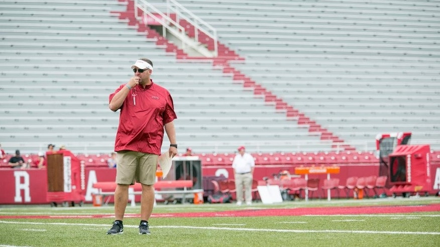Arkansas head coach Bret Bielema blows his whistle to begin a preseason NCAA college football practice at Donald W. Reynolds Razorback Stadium in Fayetteville, Ark., Saturday, Aug. 16, 2014.  (AP Photo/Gareth Patterson)