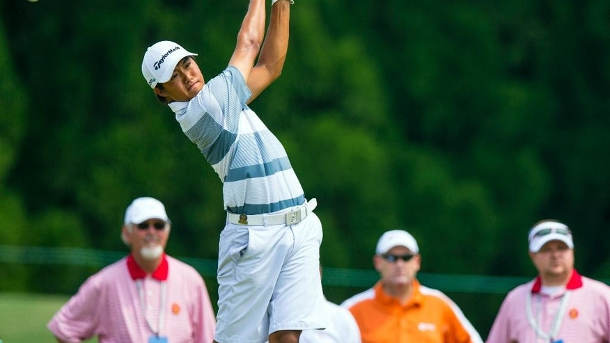 Gunn Yang, from South Korea, watches his tee shot on the sixth hole during the quarterfinal round of match play at the U.S. Amateur Championship golf tournament at Atlanta Athletic Club in Johns Creek, Ga., Friday, Aug. 15, 2014.  (AP Photo/USGA, John Mummert)