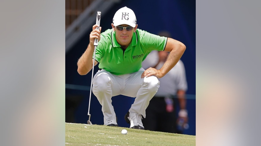 Scott Langley lines up a putt on the 18th hole during the second round of the Wyndham Championship golf tournament in Greensboro, N.C., Friday, Aug. 15, 2014. (AP Photo/Chuck Burton)