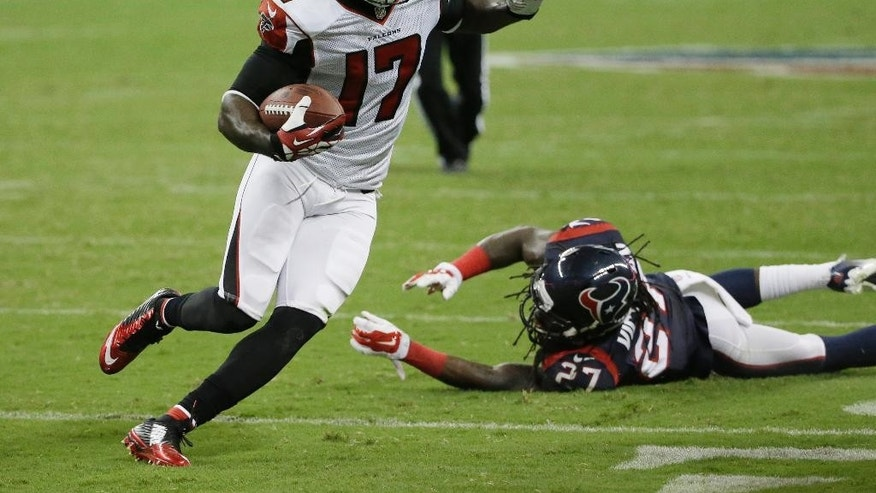 Atlanta Falcons' Devin Hester (17) evades Houston Texans' Josh Victorian (27) as he runs for a touchdown during the second quarter of an NFL preseason football game Saturday, Aug. 16, 2014, in Houston. (AP Photo/David J. Phillip)