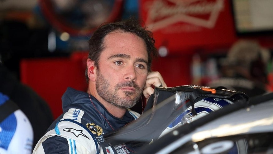 Jimmie Johnson prepares to practice for Sunday's NASCAR Sprint Cup Series auto race at Michigan International Speedway in Brooklyn, Mich., Friday, Aug. 15, 2014. Johnson, who won at Michigan is June, will need to reverse an unimpressive stretch of results lately if he's going to repeat at MIS in this weekend's Sprint Cup race. (AP Photo/Dave Frechette)