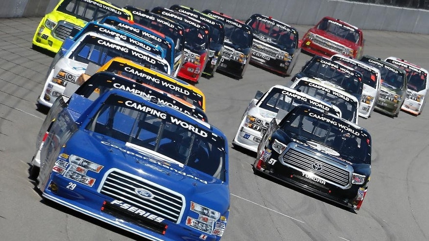 Ryan Blaney leads the field during the NASCAR Camping World truck series auto race at Michigan International Speedway in Brooklyn, Mich., Saturday, Aug. 16, 2014. (AP Photo/Bob Brodbeck)