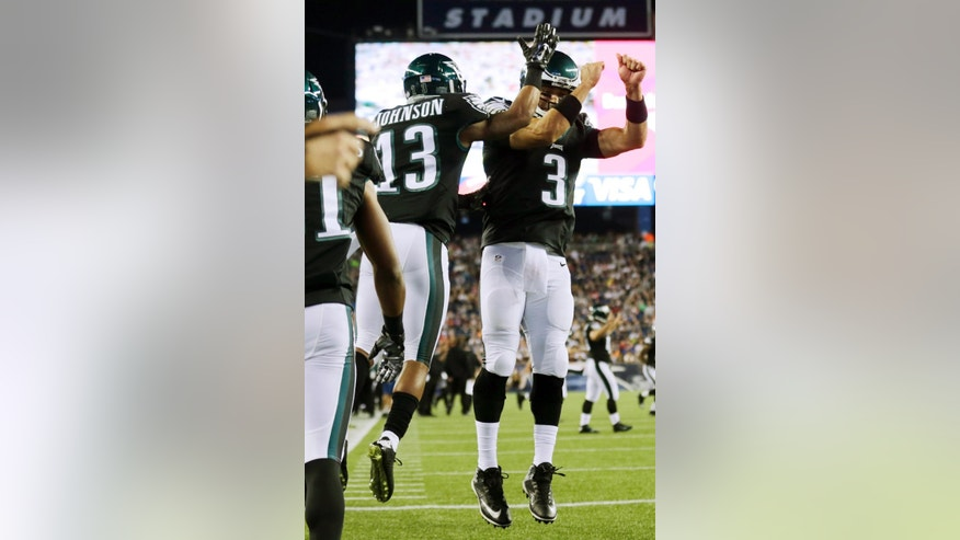 Philadelphia Eagles quarterback Mark Sanchez (3) celebrates his touchdown pass to wide receiver Damaris Johnson (13) during the second half of an NFL preseason football game against the New England Patriots on Friday, Aug. 15, 2014, in Foxborough, Mass. (AP Photo/Charles Krupa)