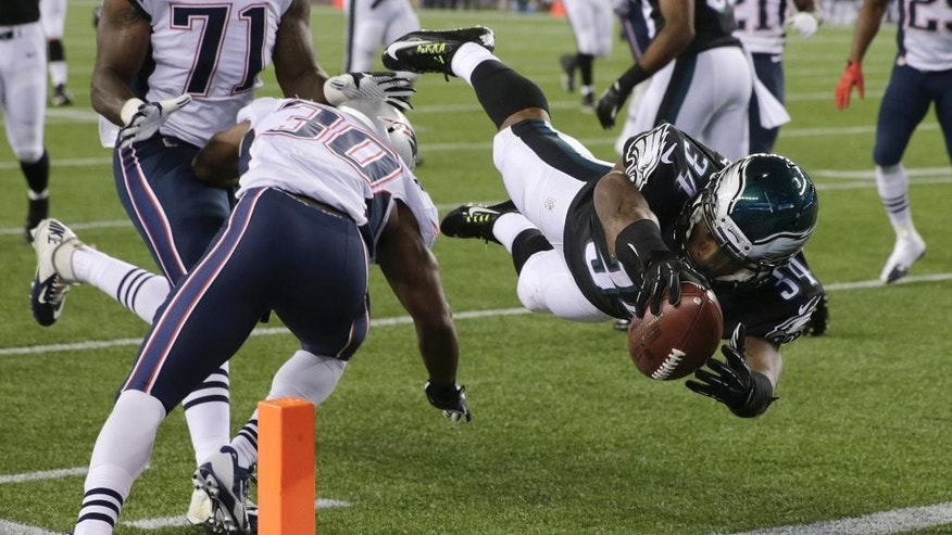 Philadelphia Eagles running back Henry Josey (34) leaps past New England Patriots strong safety Duron Harmon (30) for a touchdown in the second half of an NFL preseason football game Friday, Aug. 15, 2014, in Foxborough, Mass. (AP Photo/Charles Krupa)