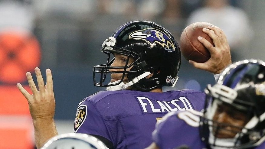 Baltimore Ravens quarterback Joe Flacco (5) throws a pass during the first half of an NFL preseason football game against the Dallas Cowboys, Saturday, Aug. 16, 2014, in Arlington, Texas. (AP Photo/Brandon Wade)