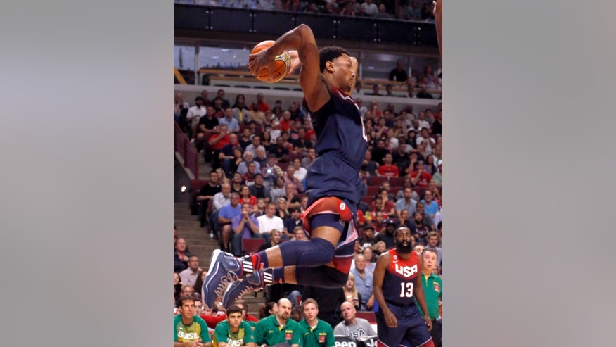 United States' Derrick Rose, of the Chicago Bulls, looks to pass during the first half of an exhibition basketball game against Brazil on Saturday, Aug. 16, 2014, in Chicago. (AP Photo/Charles Rex Arbogast)