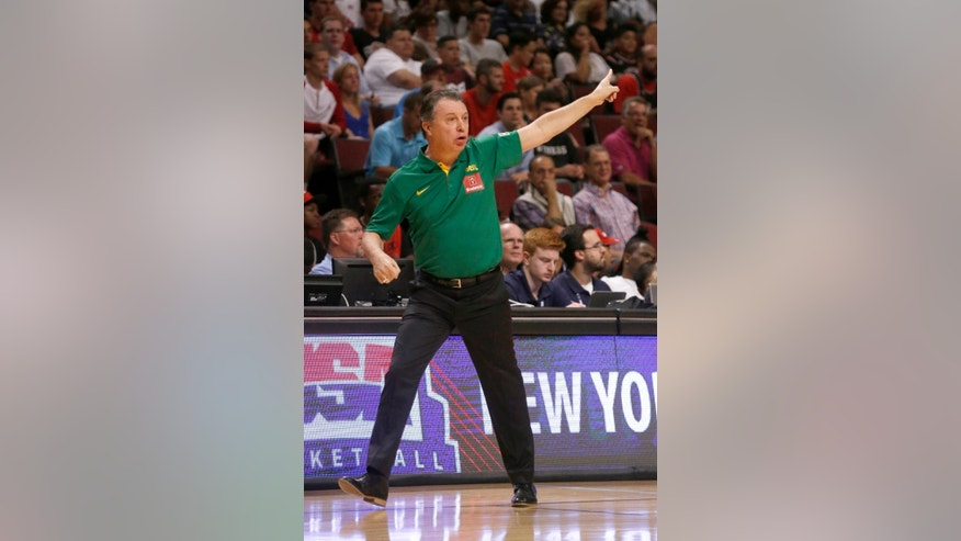 Brazil coach Ruben Pablo Magnano directs his team during the first half of an exhibition basketball game against the United States, Saturday, Aug. 16, 2014, in Chicago. (AP Photo/Charles Rex Arbogast)