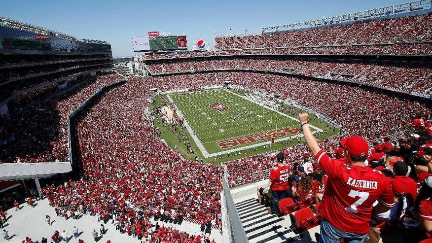Fans watch as the San Francisco 49ers play the Denver Broncos during the first half of an NFL preseason football game at Levi's Stadium in Santa Clara, Calif., Sunday, Aug. 17, 2014. (AP Photo/Tony Avelar)