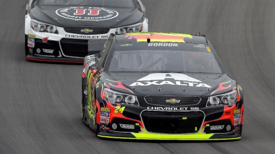 Jeff Gordon (24) races Kevin Harvick during the NASCAR Sprint Cup Series Pure Michigan 400 auto race at Michigan International Speedway in Brooklyn, Mich., Sunday, Aug. 17, 2014. (AP Photo/Paul Sancya)