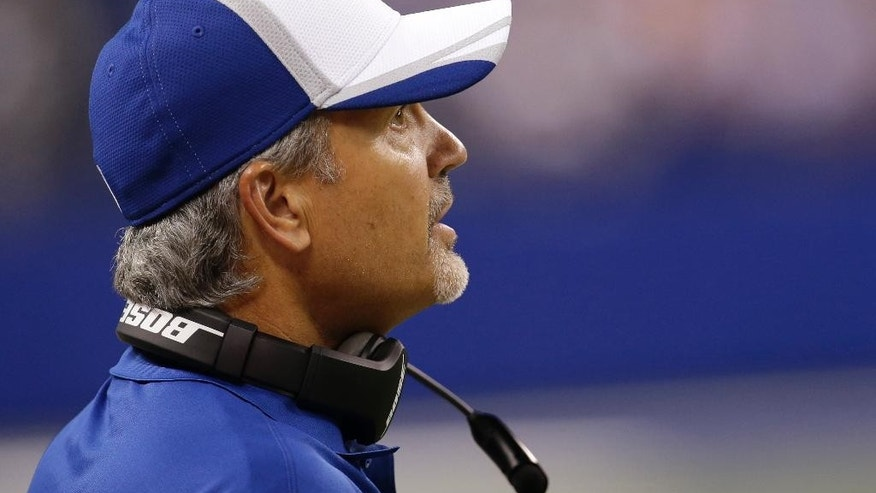 Indianapolis Colts coach Chuck Pagano questions a call during the first half of an NFL preseason football game against the New York Giants on Saturday, Aug. 16, 2014, in Indianapolis. (AP Photo/AJ Mast)