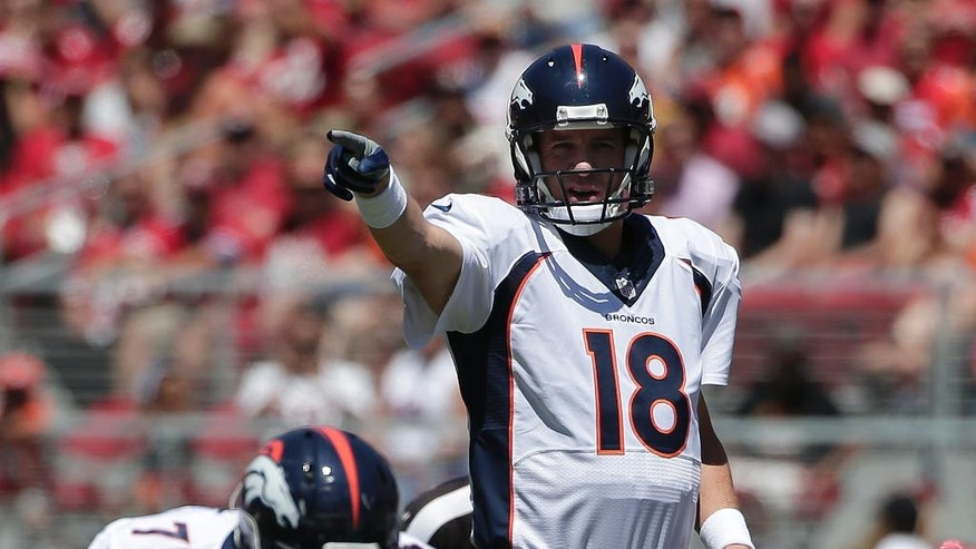 Denver Broncos quarterback Peyton Manning (18) signals at the line of scrimmage during the first quarter of an NFL preseason football game against the San Francisco 49ers in Santa Clara, Calif., Sunday, Aug. 17, 2014. (AP Photo/Marcio Jose Sanchez)