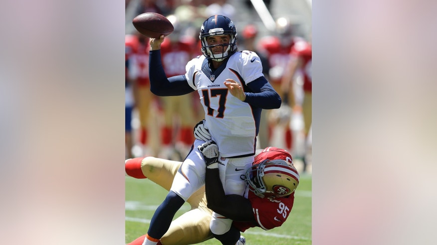 Denver Broncos quarterback Brock Osweiler (17) passes as San Francisco 49ers defensive end Cornellius Carradine (95) applies pressure during the second quarter of an NFL preseason football game in Santa Clara, Calif., Sunday, Aug. 17, 2014. (AP Photo/Ben Margot)