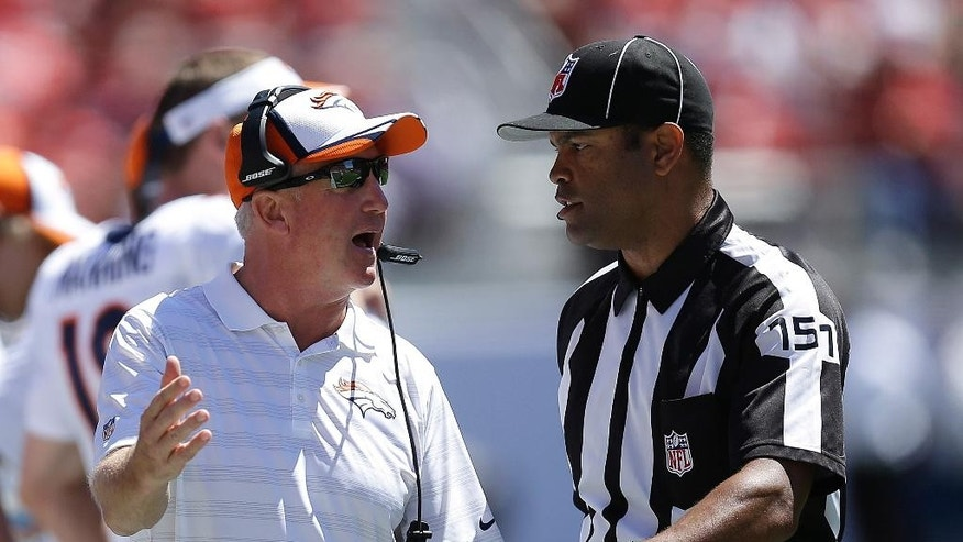 Denver Broncos head coach John Fox, left, talks with side judge Clay Reynard during the first half of an NFL preseason football game against the San Francisco 49ers in Santa Clara, Calif., Sunday, Aug. 17, 2014. (AP Photo/Ben Margot)
