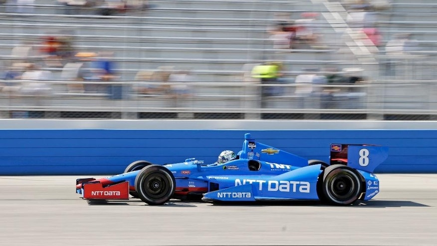 Ryan Briscoe makes his way through turn four during the Milwaukee Mile IndyCar auto race Sunday, Aug. 17, 2014, in West Allis, Wis. (AP Photo/Morry Gash)