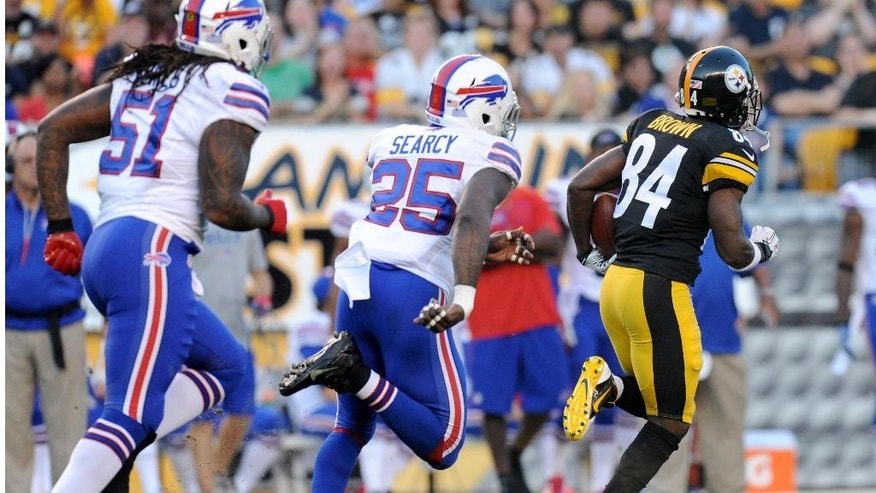 Pittsburgh Steelers wide receiver Antonio Brown (84) runs past Buffalo Bills strong safety Da'Norris Searcy (25) and middle linebacker Brandon Spikes (51) on his way to a touchdown in the first quarter of an NFL football preseason game on Saturday, Aug. 16, 2014, in Pittsburgh. (AP Photo/Don Wright)
