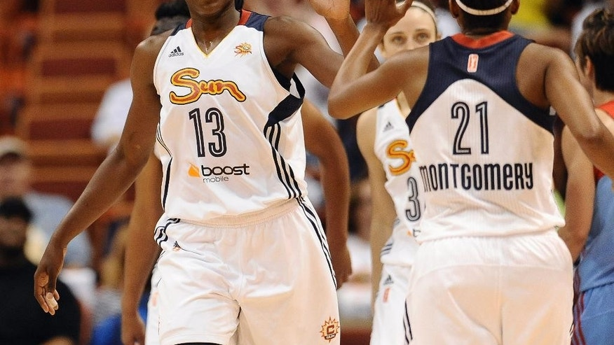 Connecticut Sun's Chiney Ogwumike high-fives with Sun's Renee Montgomery during the first half of a WNBA basketball game against the Atlanta Dream, Sunday, Aug. 17, 2014, in Uncasville, Conn. (AP Photo/Jessica Hill)