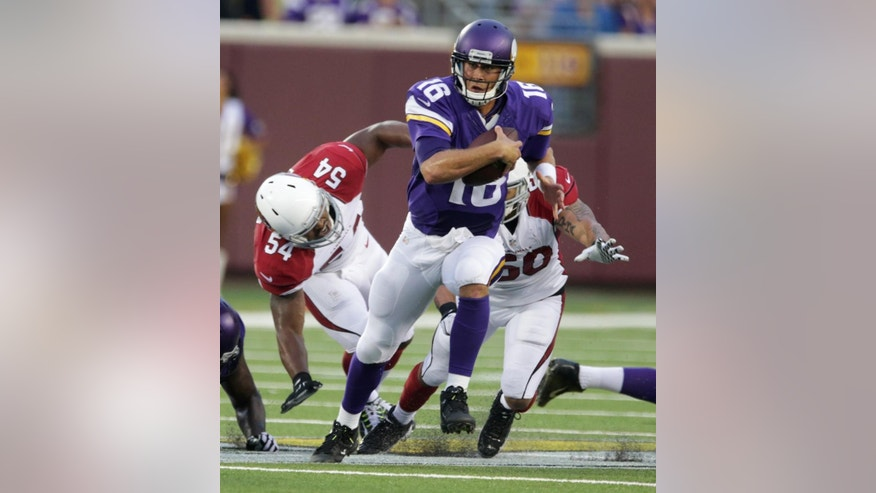 Minnesota Vikings quarterback Matt Cassel (16) runs from Arizona Cardinals inside linebacker Kenny Demens (54) during the first half of an NFL preseason football game, Saturday, Aug. 16, 2014, in Minneapolis. (AP Photo/Jim Mone)