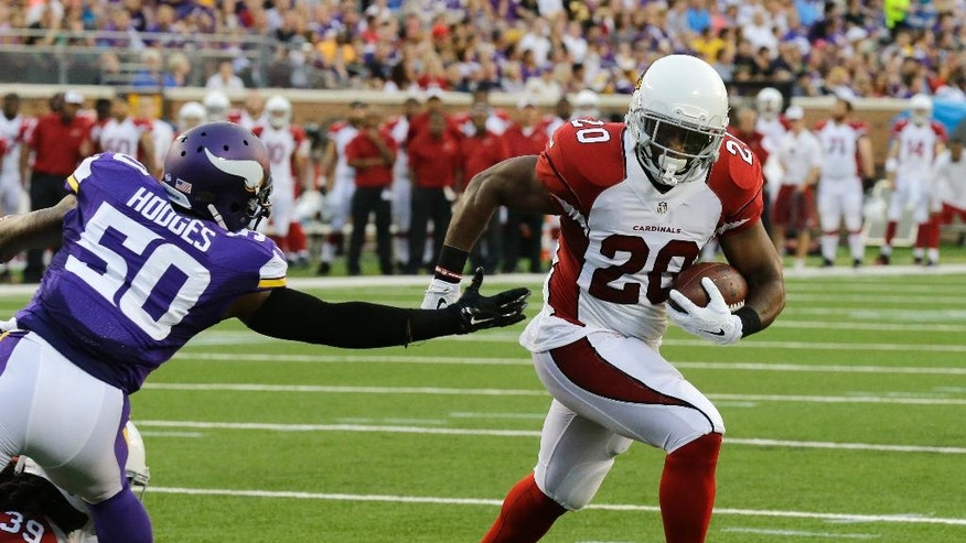 Arizona Cardinals running back Jonathan Dwyer, right, runs from Minnesota Vikings outside linebacker Gerald Hodges during a 1-yard touchdown run in the first half of an NFL preseason football game, Saturday, Aug. 16, 2014, in Minneapolis. (AP Photo/Ann Heisenfelt)