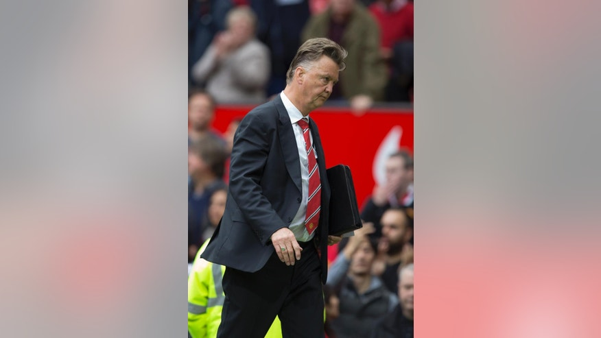 Manchester United's manager Louis van Gaal walks from the pitch after his team's 2-1 loss to Swansea City in their English Premier League soccer match at Old Trafford Stadium, Manchester, England, Saturday Aug. 16, 2014. (AP Photo/Jon Super)