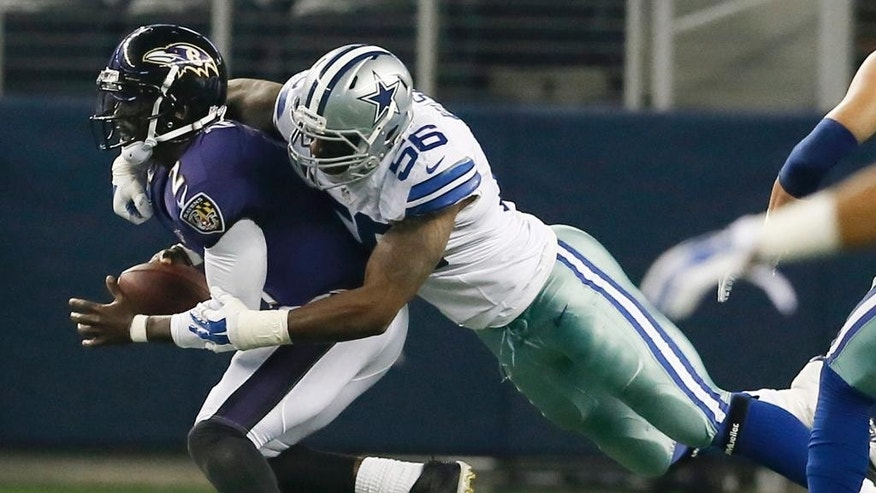Dallas Cowboys defensive end Martez Wilson (56) sacks Baltimore Ravens quarterback Tyrod Taylor (2) during the second half of an NFL preseason football game Saturday, Aug. 16, 2014, in Arlington, Texas. (AP Photo/Brandon Wade)
