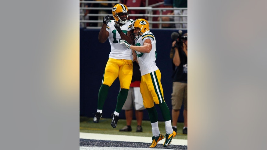 Green Bay Packers wide receiver Jeff Janis, right, is congratulated by Chris Harper after scoring on a 34-yard touchdown pass during the third quarter of an NFL preseason football game against the St. Louis Rams, Saturday, Aug. 16, 2014, in St. Louis. (AP Photo/Scott Kane)
