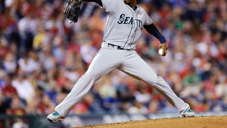 Seattle Mariners starting pitcher Roenis Elias throws a pitch in the fourth inning of an interleague baseball game against the Philadelphia Phillies on Monday, Aug. 18, 2014, in Philadelphia. (AP Photo/Michael Perez)