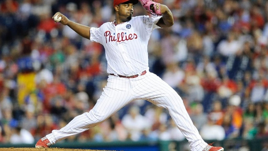 Philadelphia Phillies starting pitcher Jerome Williams throws a pitch in the third inning of an interleague baseball game against the Seattle Mariners on Monday, Aug. 18, 2014, in Philadelphia. (AP Photo/Michael Perez)