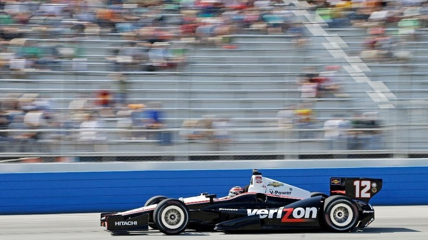 Will Power makes his way through turn four during the Milwaukee Mile IndyCar auto race Sunday, Aug. 17, 2014, in West Allis, Wis. (AP Photo/Morry Gash)
