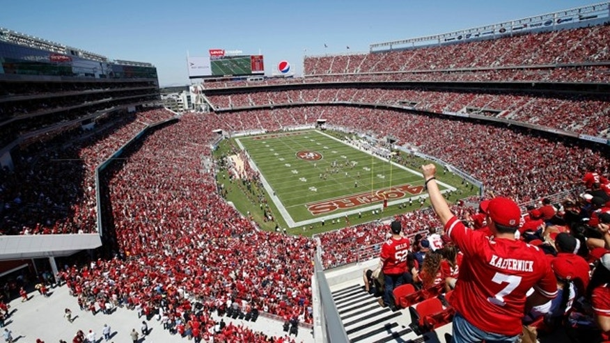 August 17, 2014: Fans watch as the San Francisco 49ers play the Denver Broncos during the first half of an NFL preseason football game at Levi's Stadium in Santa Clara, Calif. (AP Photo/Tony Avelar)
