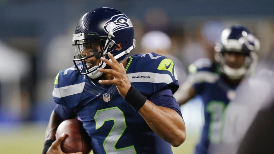 Seattle Seahawks quarterback Terrelle Pryor runs for a touchdown against the San Diego Chargers in the second half of a preseason NFL football game, Friday, Aug. 15, 2014, in Seattle. (AP Photo/Stephen Brashear)