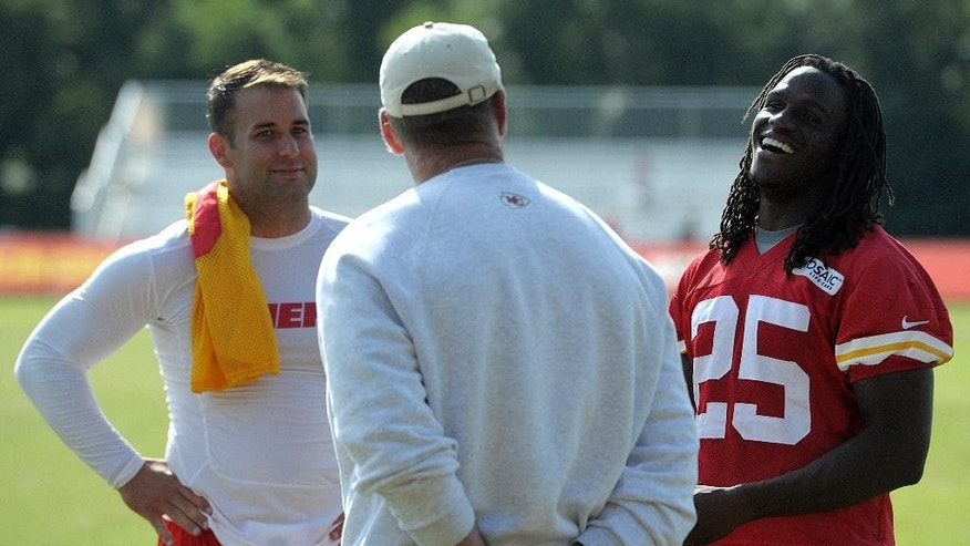 Kansas City Chiefs quarterback Chase Daniel, left,  and Jamaal Charles, right,  chat with general manager John Dorsey following NFL football training camp Thursday morning Aug. 14, 2014, on the Missouri Western State University campus in St. Joseph. Mo. (AP Photo/St. Joseph News-Press, Todd Weddle)