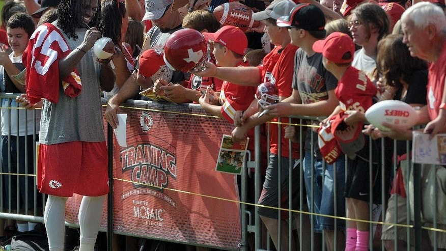 Kansas City Chiefs running back Jamaal Charles signs autographs for fans following NFL football practice Thursday morning Aug. 14, 2014, on the Missouri Western State University campus in St. Joseph. Mo. (AP Photo/St. Joseph News-Press, Todd Weddle)