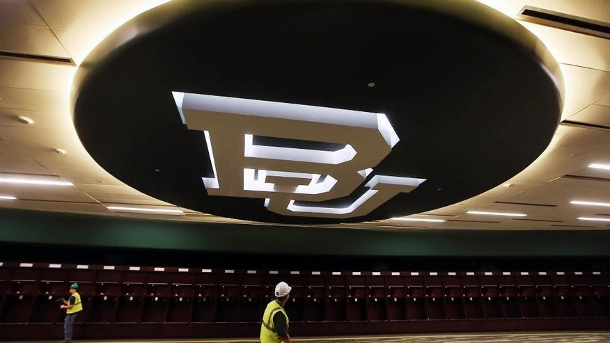 FILE - In this July 2, 2014, file photo, the Baylor University emblem  is shown on the ceiling of the new locker room at McClane Stadium in Waco, Texas. Buoyed by its Big 12 championship and the allure of its new stadium, Baylor sold out its season-opener in a matter of minutes. (AP Photo/Waco Tribune Herald, Rod Aydelotte, File)