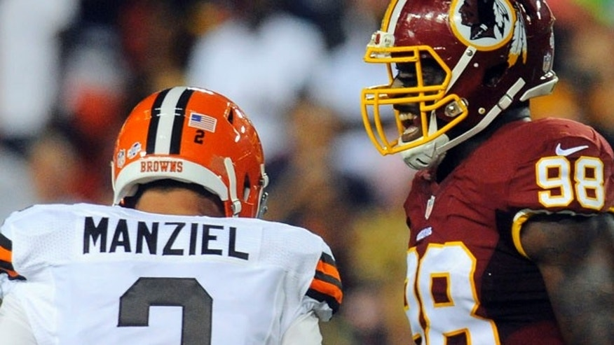 Aug. 18: Redskins outside linebacker Brian Orakpo reacts after Cleveland Browns quarterback Johnny Manziel was sacked during the first half of an NFL preseason football game. (AP)