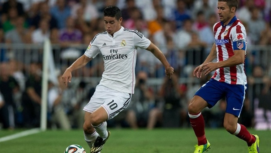 MADRID, SPAIN - AUGUST 19: James Rodriguez (L) of Real Madrid CF competes for the ball with Gabi Fernandez (R) of Atletico de Madrid during the Supercopa first leg match between Real Madrid and Club Atletico de Madrid at Estadio Santiago Bernabeu on August 19, 2014 in Madrid, Spain.  (Photo by Gonzalo Arroyo Moreno/Getty Images)