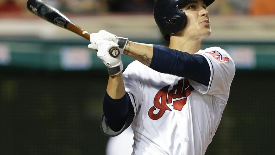 Cleveland Indians' Zach Walters watches his solo home run off Houston Astros starting pitcher Brad Peacock in the fifth inning of a baseball game Friday, Aug. 22, 2014, in Cleveland. (AP Photo/Mark Duncan)