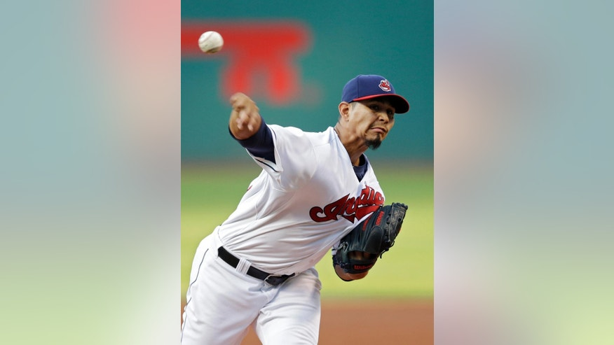 Cleveland Indians starting pitcher Carlos Carrasco delivers against the Houston Astros in the first inning of a baseball game Friday, Aug. 22, 2014, in Cleveland. (AP Photo/Mark Duncan)