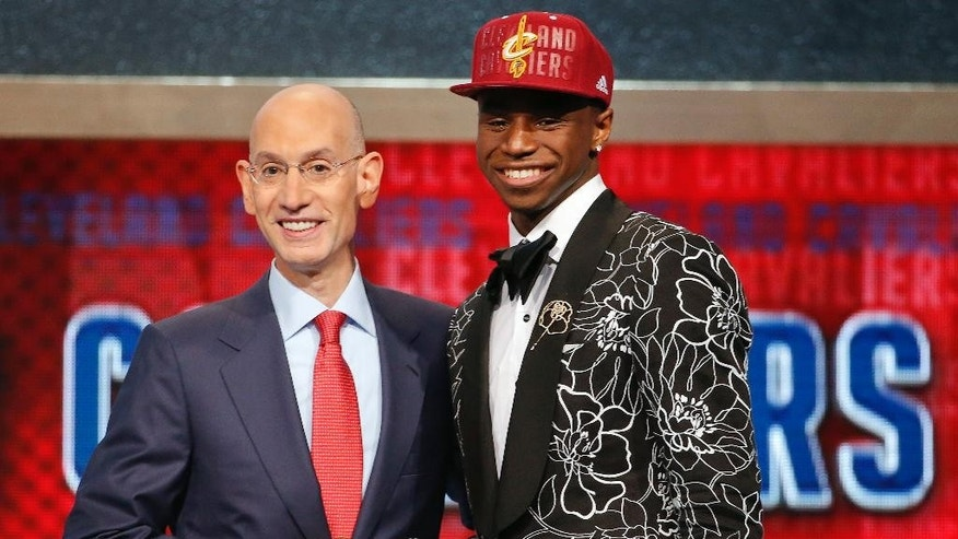 FILE - In this June 25, 2014, file photo, NBA Commissioner Adam Silver, left, congratulates Andrew Wiggins of Kansas who was selected by the Cleveland Cavaliers as the No. 1 pick in the 2014 NBA basketball draft in New York. The Minnesota Timberwolves, Cavaliers and Philadelphia 76ers completed a blockbuster trade sending Kevin Love to team up with LeBron James in Cleveland for 2014 No. 1 draft pick Andrew Wiggins on Saturday, Aug. 23, 2014, a person familiar with the trade said. The Timberwolves are getting Wiggins and former top pick Anthony Bennett from Cleveland and veteran forward Thaddeus Young from Philadelphia. The 76ers get a 2015 first-round draft choice from Cleveland, and guard Alexey Shved and forward Luc Mbah a Moute from Minnesota. (AP Photo/Jason DeCrow, File)