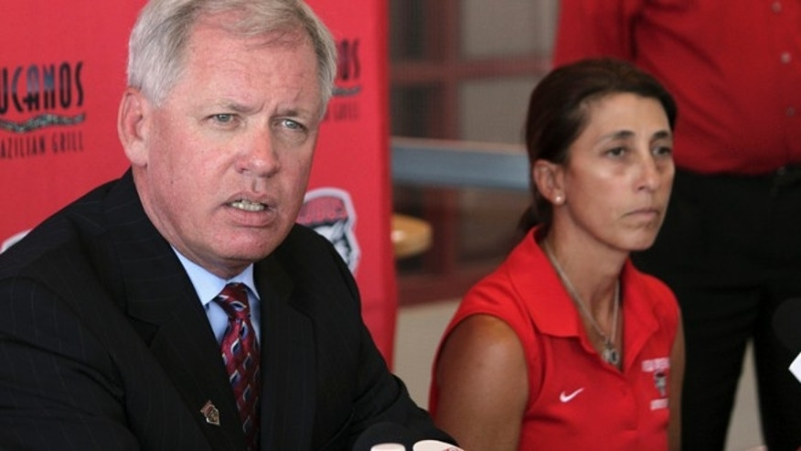Aug. 20, 2014: University of New Mexico athletic director Paul Krebs, left, discusses a hazing incident involving the women's soccer team as head coach Kit Vela sits beside him during a news conference in Albuquerque, N.M.