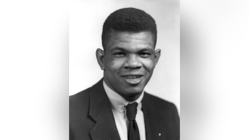In this undated image provided by the University of Nebraska, Charles Bryant, who in 1953 was among the first two African-Americans to letter for the Huskers since 1913, poses for a photo. On Saturday, Aug. 30, 2014, Brandin Bryant, the grandson of Charles, will play in Lincoln with Florida Atlantic against the Huskers. (AP Photo/University of Nebraska)