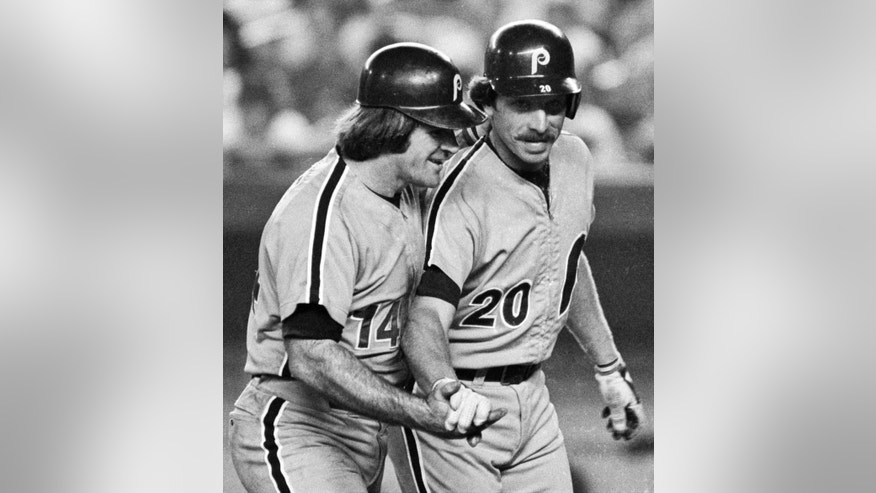 FILE - In this Aug. 15, 1981, file photo, Philadelphia Phillies' Mike Schmidt, right, is congratulated by teammate Pete Rose after hitting a two-run home run against the New York Mets in the third inning of a baseball game at New York's Shea Stadium. On the 25th anniversary of Rose's banishment from baseball, Schmidt says it is time to forgive him and put him in the Hall of Fame. (AP Photo/Ray Stubblebine, File)