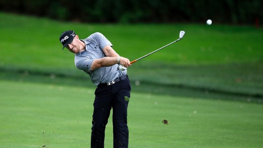 Hunter Mahan hits a fairway shot on the third hole during the final round of play at The Barclays golf tournament Sunday, Aug. 24, 2014, in Paramus, N.J. (AP Photo/Mel Evans)