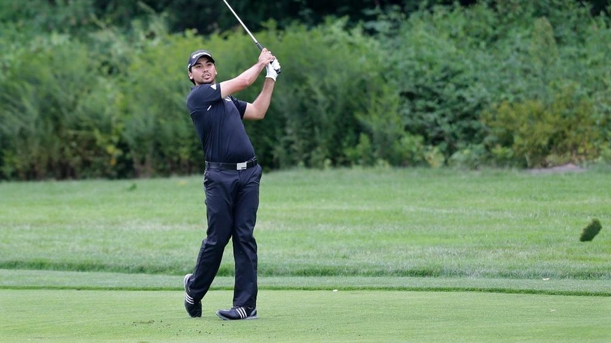 Jason Day, of Australia, hits a fairway shot on the third hole during the final round of play at The Barclays golf tournament Sunday, Aug. 24, 2014, in Paramus, N.J. (AP Photo/Mel Evans)