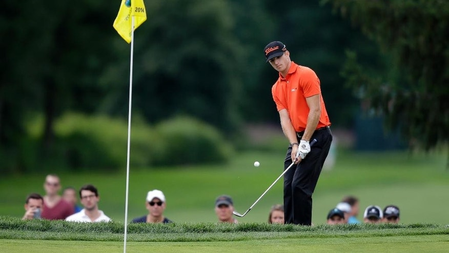 Morgan Hoffman, of Wyckoff, N.J., hits a shot onto the green on the third hole during the final round of play at The Barclays golf tournament Sunday, Aug. 24, 2014, in Paramus, N.J. (AP Photo/Mel Evans)