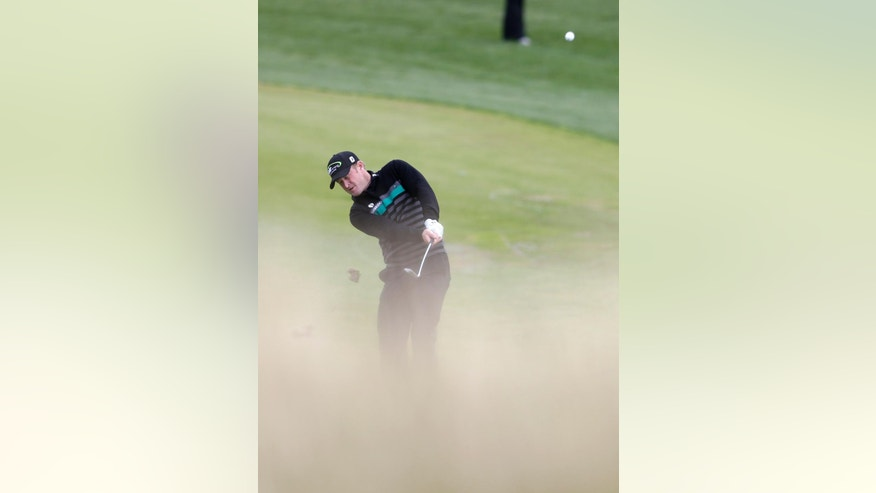 Jamie Donaldson from Wales plays a shot during the golf Czech Masters European Tour Event in Vysoky Ujezd, Czech Republic, Sunday, Aug. 24, 2014. (AP Photo/Petr David Josek)