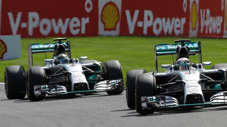 Mercedes driver Lewis Hamilton of Britain  leads his teammate Mercedes driver Nico Rosberg of Germany during the Belgium Formula One Grand Prix at the Spa-Francorchamps circuit, Belgium, Sunday, Aug. 24, 2014.  (AP Photo/Luca Bruno)